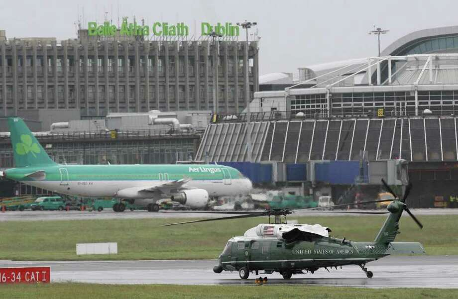 DUBLIN, IRELAND - MAY 23: U.S. President Barack Obama and first lady Michelle Obama take off in Marine One upon their arrival at the Dublin Airport May 23, 2011 in Dublin, Ireland.  Obama is visiting Ireland for one day. He will meet with distant relatives in Moneygall and speak at a rally in central Dublin after a concert.  (Photo by Irish Government - Pool /Getty Images) Photo: Pool, Getty Images / 2011 Getty Images