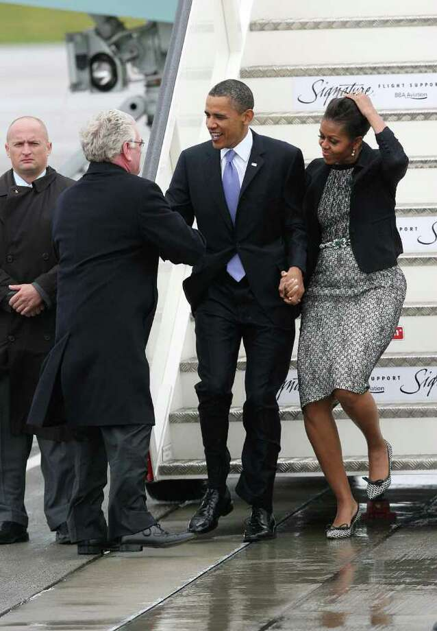 DUBLIN, IRELAND - MAY 23: U.S. President Barack Obama and first lady Michelle Obama are greeted by Tanaiste Eamon Gilmore upon their arrival at the Dublin Airport May 23, 2011 in Dublin, Ireland.  Obama is visiting Ireland for one day. He will meet with distant relatives in Moneygall and speak at a rally in central Dublin after a concert.  (Photo by Irish Government - Pool /Getty Images) Photo: Pool, Getty Images / 2011 Getty Images