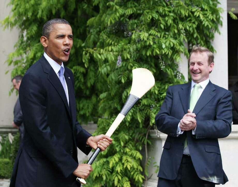 DUBLIN, IRELAND - MAY 23:  U.S. President Barack Obama (L) holds a hurley after it was given to him by Irish Prime Minister Taoiseach Enda Kenny at Farmleigh May 23, 2011 in Dublin, Ireland. U.S. President Obama is on a one-day visit to Ireland, where will meet with distant relatives in Moneygall and then speak at a rally in central Dublin after a concert.   (Photo by Irish Government-Pool /Getty Images) Photo: Pool, Getty Images / 2011 Getty Images