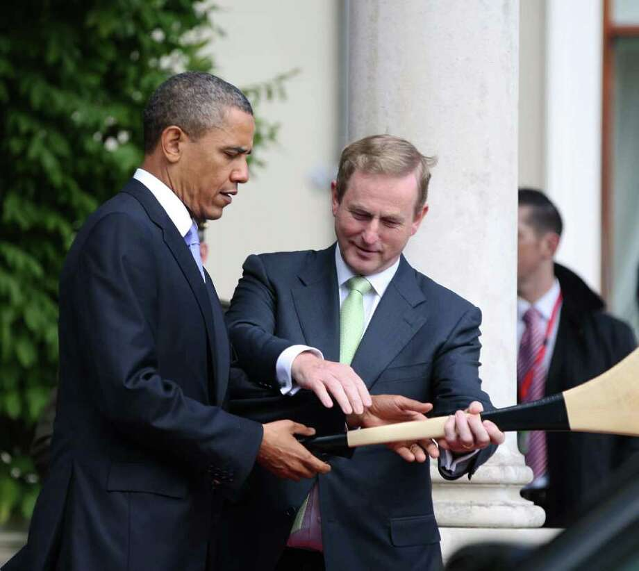 DUBLIN, IRELAND - MAY 23:  U.S. President Barack Obama (L) is presented with a hurley by Irish Prime Minister Taoiseach Enda Kenny at Farmleigh May 23, 2011 in Dublin, Ireland. U.S. President Obama is on a one-day visit to Ireland, where will meet with distant relatives in Moneygall and then speak at a rally in central Dublin after a concert.   (Photo by Irish Government-Pool /Getty Images) Photo: Pool, Getty Images / 2011 Getty Images