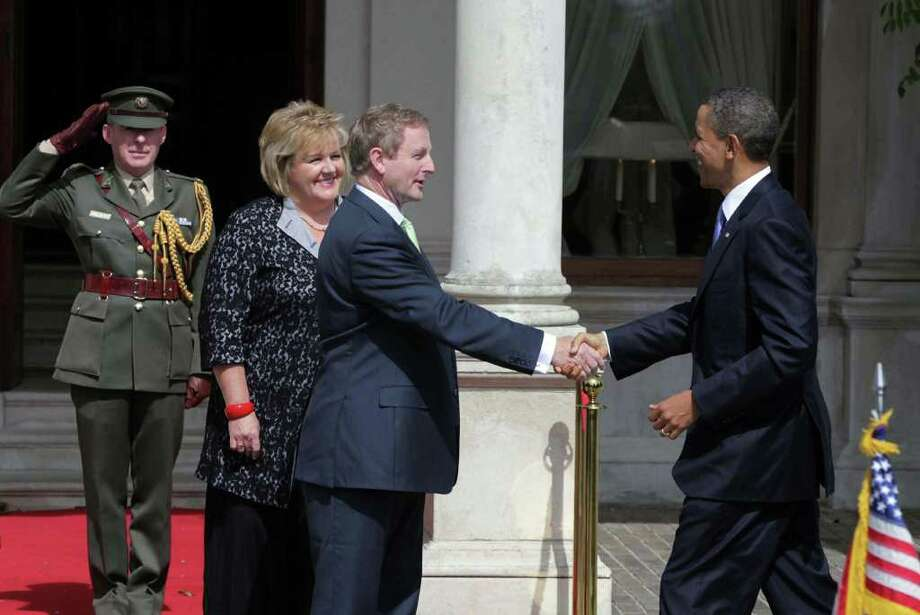 DUBLIN, IRELAND - MAY 23:  Irish Prime Minister Taoiseach Enda Kenny (2nd R) greets U.S. President Barack Obama (R) as his wife Fionnuala Kenny (2nd L) looks on at Farmleigh May 23, 2011 in Dublin, Ireland. U.S. President Obama is on a one-day visit to Ireland, where will meet with distant relatives in Moneygall and then speak at a rally in central Dublin after a concert.   (Photo by Irish Government-Pool /Getty Images) Photo: Pool, Getty Images / 2011 Getty Images