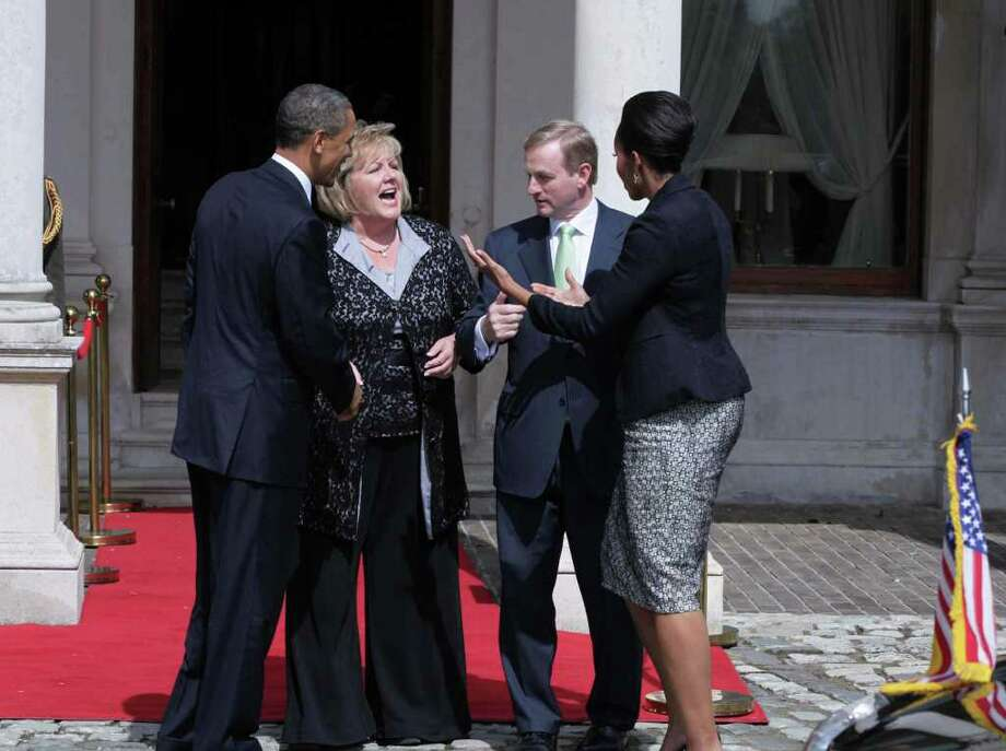 DUBLIN, IRELAND - MAY 23:  Irish Prime Minister Taoiseach Enda Kenny (2nd R) and his wife Fionnuala Kenny (2nd L) greets U.S. President Barack Obama (L) and first lady Michelle Obama (R) at Farmleigh May 23, 2011 in Dublin, Ireland. U.S. President Obama is on a one-day visit to Ireland, where will meet with distant relatives in Moneygall and then speak at a rally in central Dublin after a concert.   (Photo by Irish Government-Pool /Getty Images) Photo: Pool, Getty Images / 2011 Getty Images