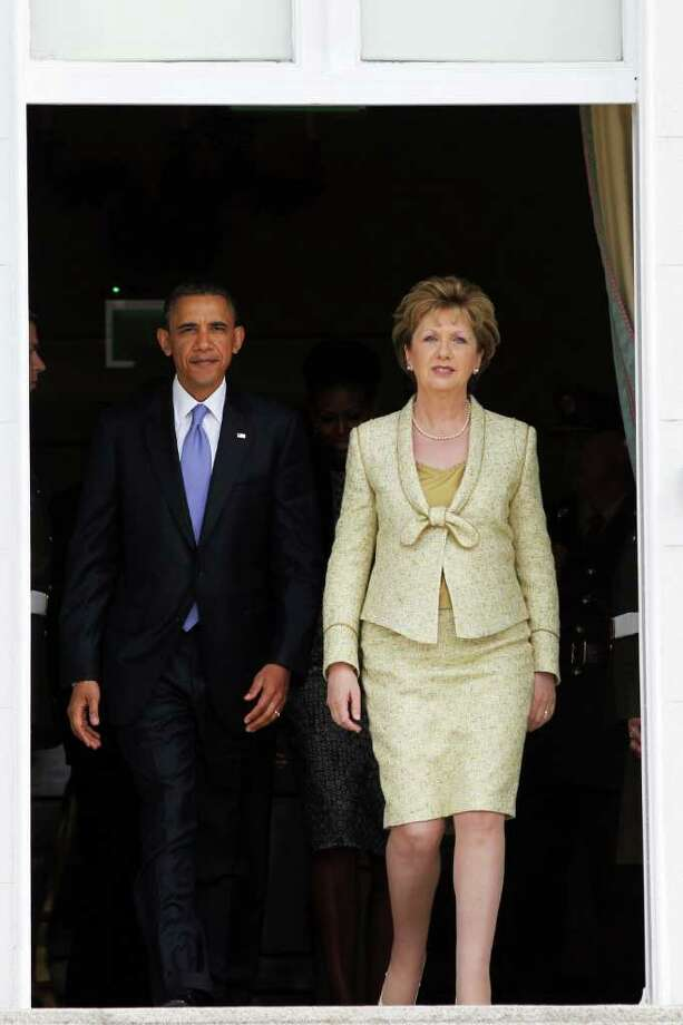 DUBLIN, IRELAND - MAY 23: U.S. President Barack Obama and Irish President Mary McAleese walk out of Aras an Uachtarain, the official residence of the President of Ireland, May 23, 2011 in Dublin, Ireland.  Obama is visiting Ireland for one day. He will meet with distant relatives in Moneygall and speak at a rally in central Dublin after a concert.  (Photo by Irish Government - Pool /Getty Images) Photo: Pool, Getty Images / 2011 Getty Images