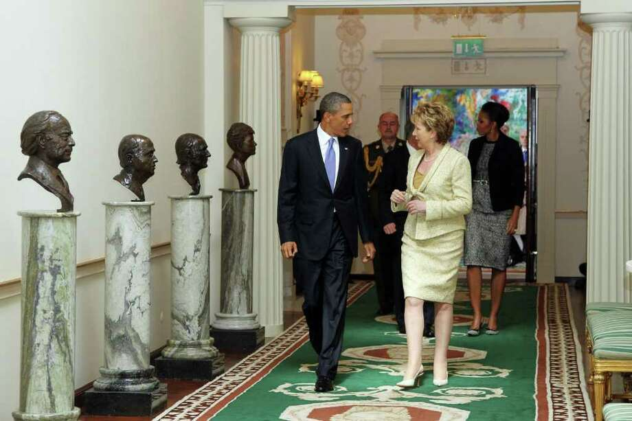 DUBLIN, IRELAND - MAY 23: U.S. President Barack Obama and Irish President Mary McAleese speak while walking through the Francini corridor in Aras an Uachtarain, the official residence of the President of Ireland, ahead of Dr. Martin McAleese and first lady Michelle Obama May 23, 2011 in Dublin, Ireland.  Obama is visiting Ireland for one day. He will meet with distant relatives in Moneygall and speak at a rally in central Dublin after a concert.  (Photo by Irish Government - Pool /Getty Images) Photo: Pool, Getty Images / 2011 Getty Images