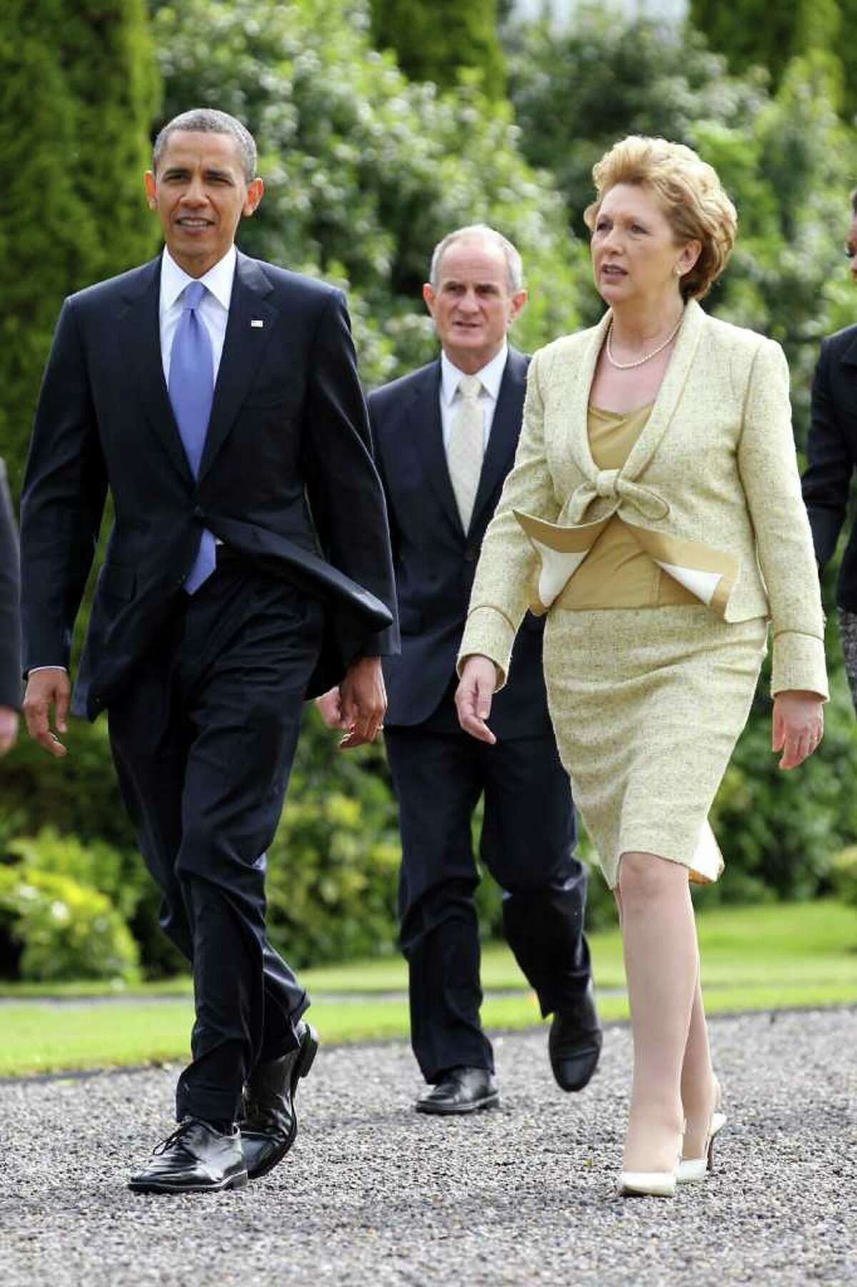 DUBLIN, IRELAND - MAY 23: U.S. President Barack Obama and Irish President Mary McAleese depart Aras an Uachtarain, the official residence of the President of Ireland, ahead of Dr. Martin McAleese May 23, 2011 in Dublin, Ireland. Obama is visiting Ireland for one day. He will meet with distant relatives in Moneygall and speak at a rally in central Dublin after a concert. (Photo by Irish Government - Pool /Getty Images)