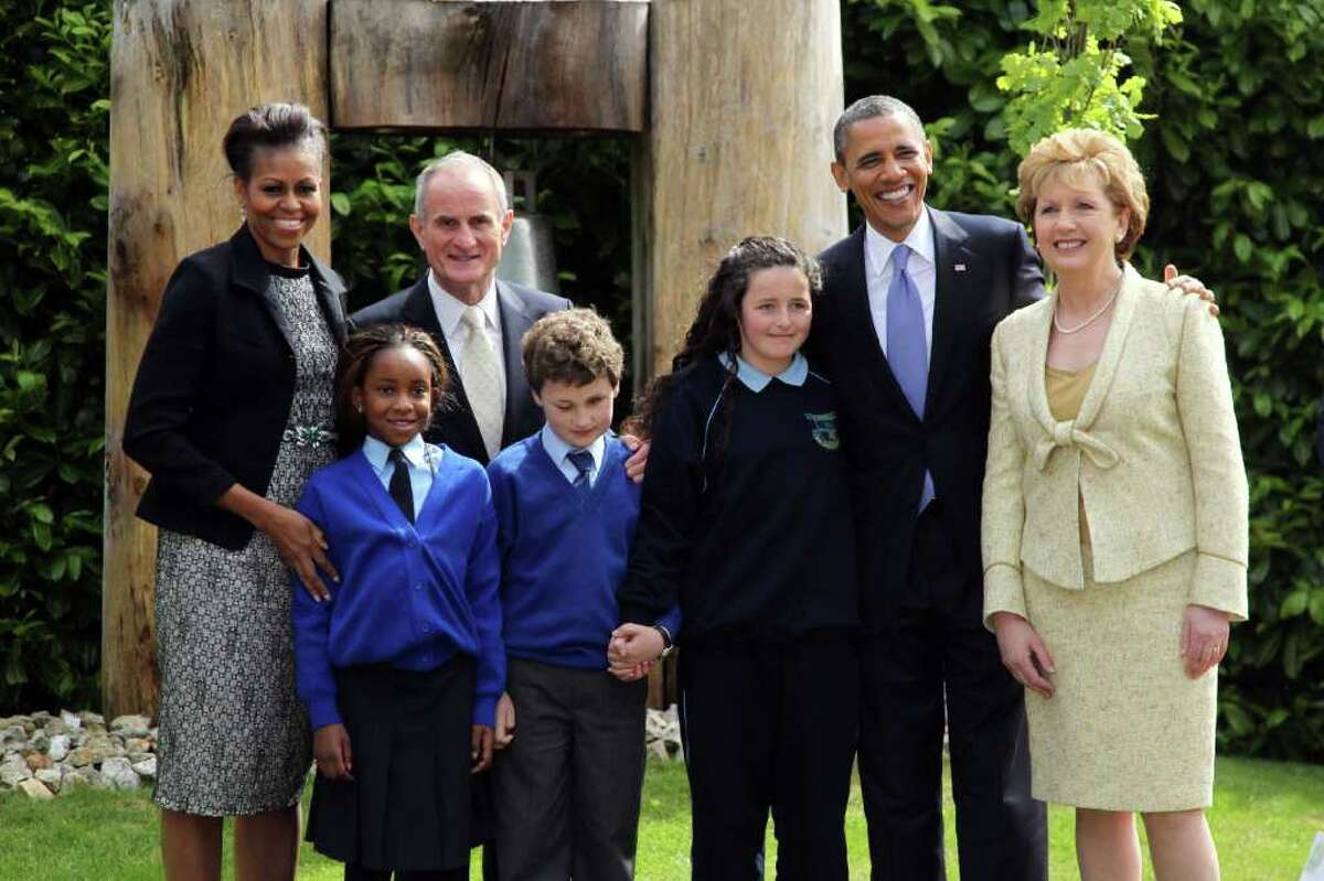 DUBLIN, IRELAND - MAY 23: (L -R) First lady Michelle Obama, Dr. Martin McAleese, U.S. President Barack Obama and Irish President Mary McAleese pose with school children (L -R) Onyedika Ukachukwu, Colm Dunne, and Maragaret McDonagh after a tree planting ceremony at Aras an Uachtarain, the official residence of the President of Ireland, May 23, 2011 in Dublin, Ireland. Obama is visiting Ireland for one day. He will meet with distant relatives in Moneygall and speak at a rally in central Dublin after a concert. (Photo by Irish Government - Pool /Getty Images)