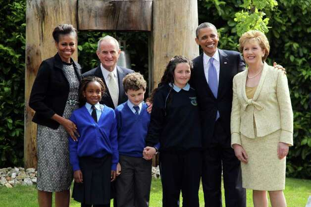DUBLIN, IRELAND - MAY 23: (L -R) First lady Michelle Obama, Dr. Martin McAleese, U.S. President Barack Obama and Irish President Mary McAleese pose with school children (L -R) Onyedika Ukachukwu, Colm Dunne, and Maragaret McDonagh after a tree planting ceremony at Aras an Uachtarain, the official residence of the President of Ireland, May 23, 2011 in Dublin, Ireland.  Obama is visiting Ireland for one day. He will meet with distant relatives in Moneygall and speak at a rally in central Dublin after a concert.  (Photo by Irish Government - Pool /Getty Images) Photo: Pool, Getty Images / 2011 Getty Images