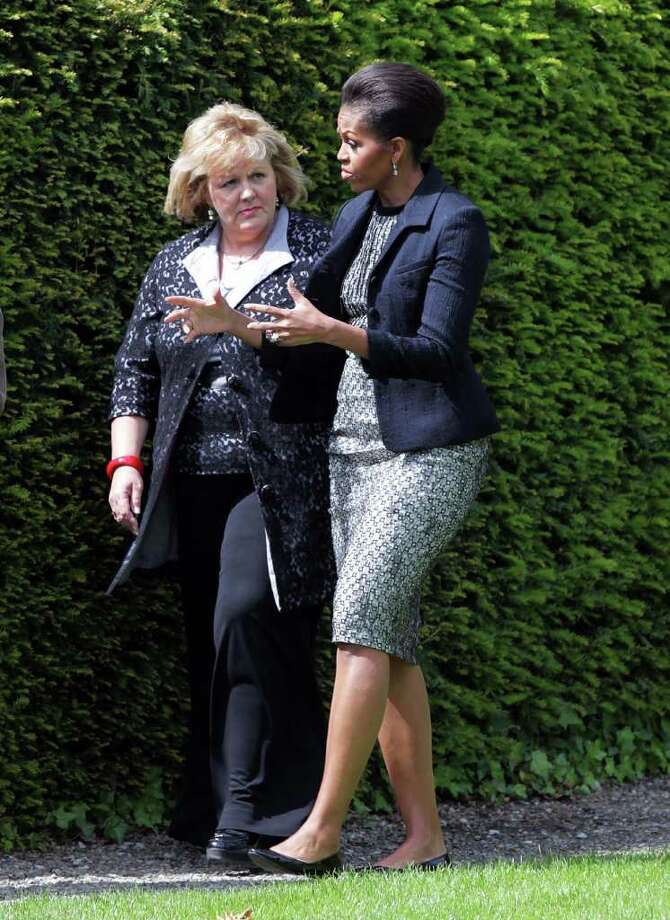 DUBLIN, IRELAND - MAY 23:  Fionnuala Kenny (L), the Taoiseach Enda Kenny's wife, and lady Michelle Obama walk in the garden at Farmeligh May 23, 2011 in Dublin, Ireland. U.S. President Barack Obama is on a one-day visit to Ireland, where will meet with distant relatives in Moneygall and then speak at a rally in central Dublin after a concert.   (Photo by Irish Government-Pool /Getty Images) Photo: Pool, Getty Images / 2011 Getty Images