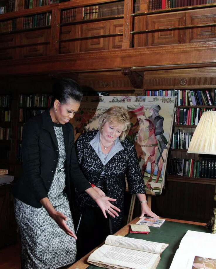 DUBLIN, IRELAND - MAY 23:  Fionnuala Kenny (R), the Taoiseach Enda Kenny's wife, shows first lady Michelle Obama a copy of topographia Hibernia from the Benjamin Iveagh Library during a tour of Farmeligh House May 23, 2011 in Dublin, Ireland. U.S. President Barack Obama is on a one-day visit to Ireland, where will meet with distant relatives in Moneygall and then speak at a rally in central Dublin after a concert.   (Photo by Irish Government-Pool /Getty Images) Photo: Pool, Getty Images / 2011 Getty Images