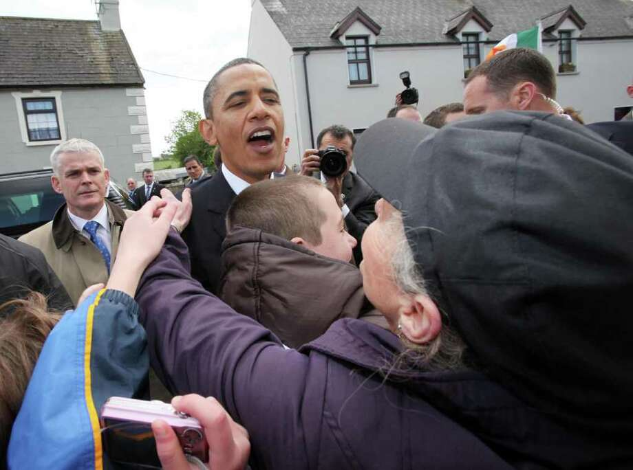 MONEYGALL, IRELAND - MAY 23:  U.S. President Barack Obama greets the locals in his ancestral home of Moneygall on May 23, 2011 in Moneygall, Ireland. U.S. President Obama is visiting Ireland for one day at the start of a week long tour of Europe. He will meet with distant relatives in Moneygall and speak at a rally in central Dublin after a concert.   (Photo by Irish Government - Pool/Getty Images) Photo: Getty Images
