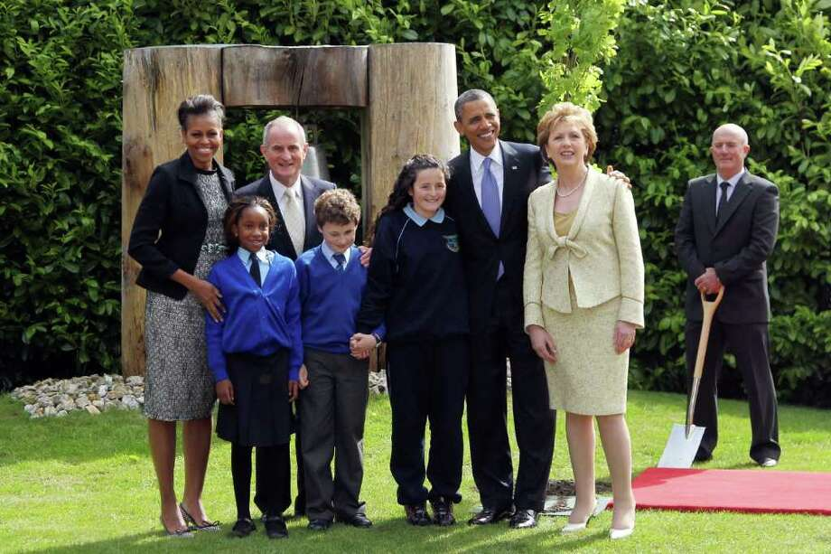 DUBLIN, IRELAND - MAY 23:  (L to R) First lady Michelle Obama, Onyedika Ukachukwu, Dr Martin McAleese, Colm Dunne, Maragaret McDonagh, U.S.  President Barack Obama, President of Ireland Mary McAleese and Head Gardener Robert Norris attend a tree planting ceremony at Aras an Uachtarain May 23, 2011 in Dublin, Ireland. U.S. President Obama is on a one-day visit to Ireland, where will meet with distant relatives in Moneygall and then speak at a rally in central Dublin after a concert.   (Photo by Irish Government-Pool /Getty Images) Photo: Pool, Getty Images / 2011 Getty Images