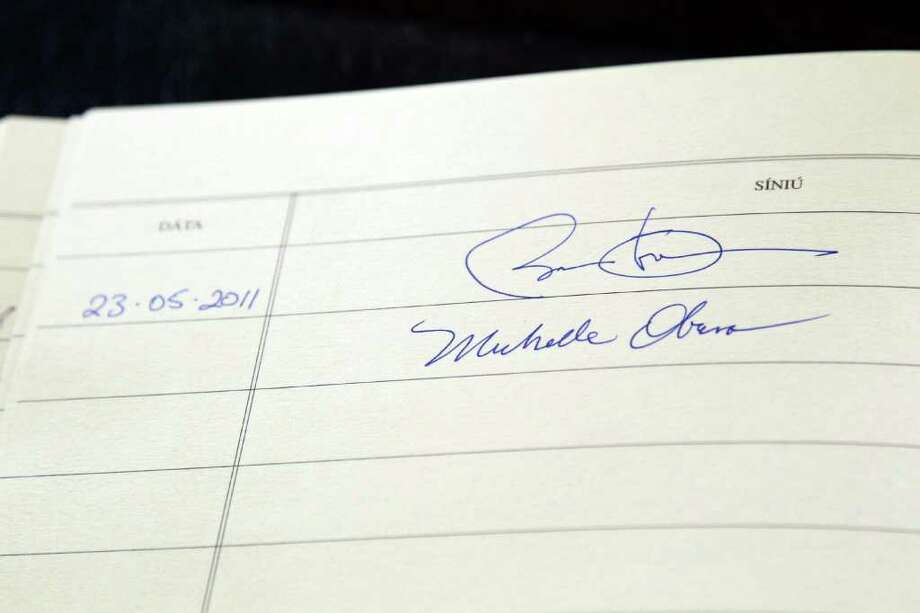 DUBLIN, IRELAND - MAY 23:  The signatures of U.S. President Barack Obama and first lady Michelle Obamas are seen in the visitors book at Aras an Uachtarain May 23, 2011 in Dublin, Ireland. U.S. President Obama is on a one-day visit to Ireland, where will meet with distant relatives in Moneygall and then speak at a rally in central Dublin after a concert.   (Photo by Irish Government-Pool /Getty Images) Photo: Pool, Getty Images / 2011 Getty Images