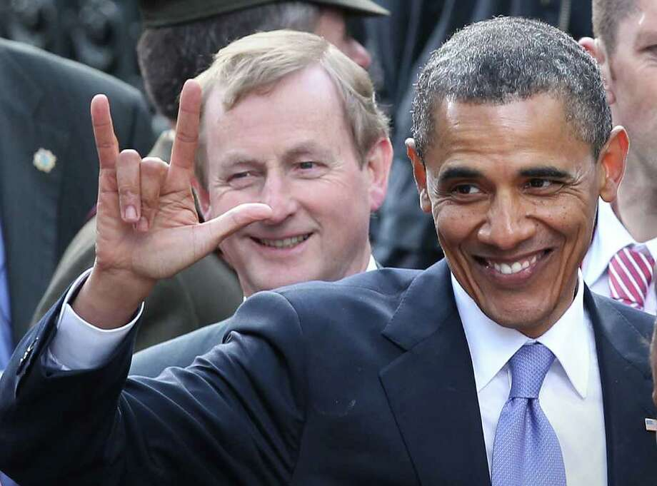 DUBLIN, IRELAND - MAY 23:  US President Barack Obama gestures after speaking in College Green as Irish Prime Minister Enda Kenny looks on on May 23, 2011 in Dublin, Ireland. U.S. President Obama is visiting Ireland for one day. Earlier he met with Irish President Mary McAleese, Taoiseach (Prime Minister) of Ireland Enda Kenny and visited his ancestral home  in Moneygall, County Offaly.   (Photo by Peter Macdiarmid/Getty Images) Photo: Peter Macdiarmid, Getty Images / 2011 Getty Images