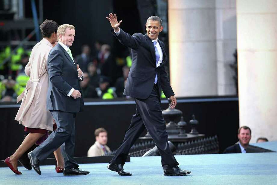 DUBLIN, IRELAND - MAY 23:  US President Barack Obama waves after speaking in College Green as Irish Prime Minister Enda Kenny looks on on May 23, 2011 in Dublin, Ireland. U.S. President Obama is visiting Ireland for one day. Earlier he met with Irish President Mary McAleese, Taoiseach (Prime Minister) of Ireland Enda Kenny and visited his ancestral home  in Moneygall, County Offaly.  (Photo by Peter Macdiarmid/Getty Images) Photo: Peter Macdiarmid, Getty Images / 2011 Getty Images