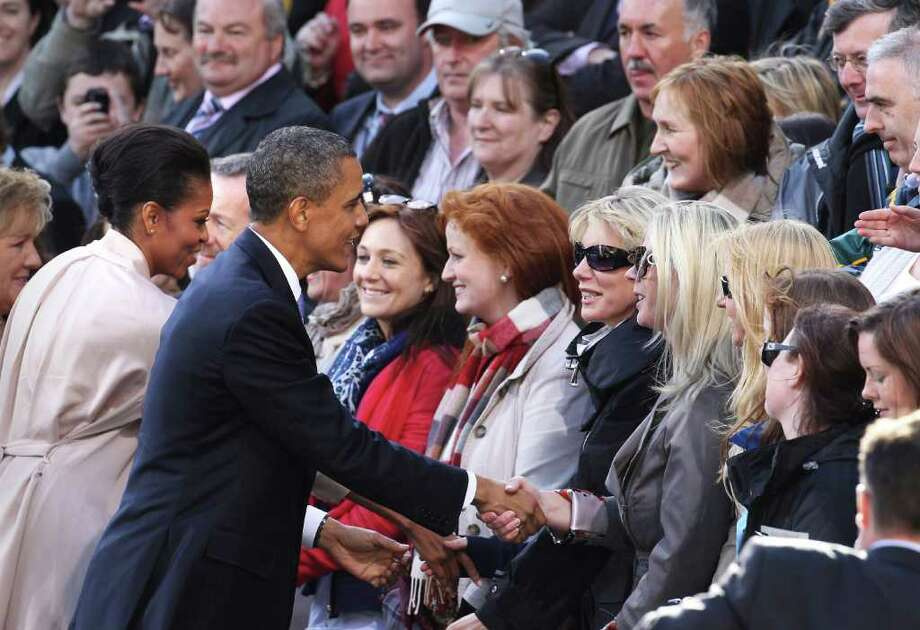 DUBLIN, IRELAND - MAY 23:  US President Barack Obama and First Lady Michelle Obama greet well wishers in College Green on May 23, 2011 in Dublin, Ireland. U.S. President Obama is visiting Ireland for one day. Earlier he met with Irish President Mary McAleese, Taoiseach (Prime Minister) of Ireland Enda Kenny and visited his ancestral home  in Moneygall, County Offaly.  (Photo by Peter Macdiarmid/Getty Images) Photo: Peter Macdiarmid, Getty Images / 2011 Getty Images