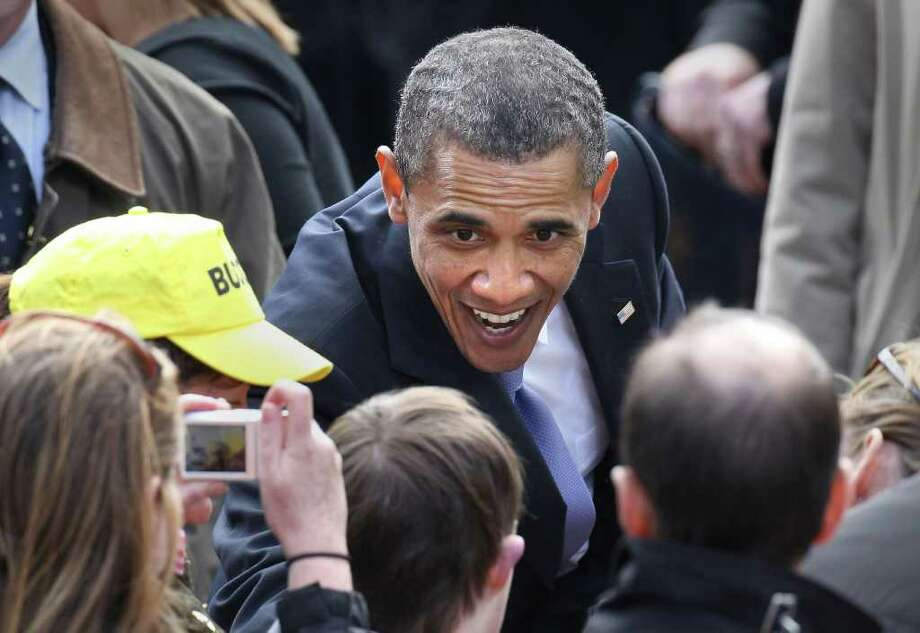 DUBLIN, IRELAND - MAY 23:  US President Barack Obama greets well wishers after speaking in College Green on May 23, 2011 in Dublin, Ireland. U.S. President Obama is visiting Ireland for one day. Earlier he met with Irish President Mary McAleese, Taoiseach (Prime Minister) of Ireland Enda Kenny and visited his ancestral home  in Moneygall, County Offaly.  (Photo by Peter Macdiarmid/Getty Images) Photo: Peter Macdiarmid, Getty Images / 2011 Getty Images