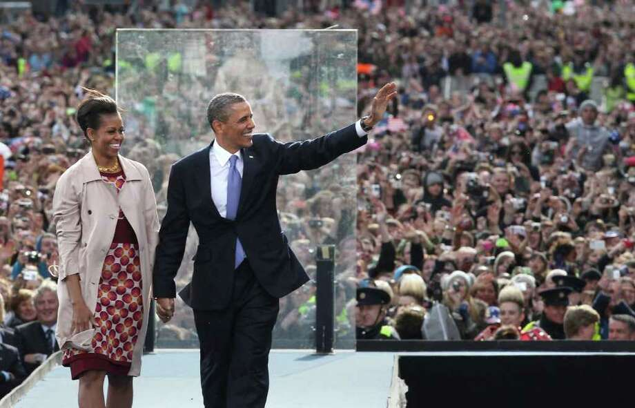 DUBLIN, IRELAND - MAY 23:  US President Barack Obama waves to crowds as he stands with First Lady Michelle Obama in College Green on May 23, 2011 in Dublin, Ireland. U.S. President Obama is visiting Ireland for one day. Earlier he met with Irish President Mary McAleese, Taoiseach (Prime Minister) of Ireland Enda Kenny and visited his ancestral home  in Moneygall, County Offaly.  (Photo by Peter Macdiarmid/Getty Images) Photo: Peter Macdiarmid, Getty Images / 2011 Getty Images