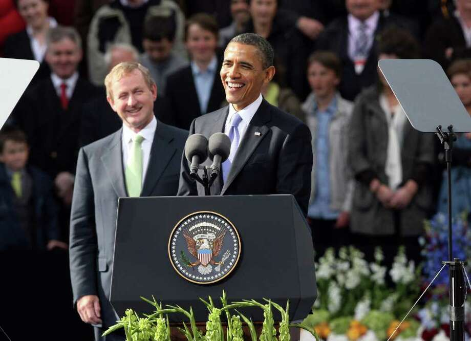 DUBLIN, IRELAND - MAY 23:  US President Barack Obama makes a speech at College Green with Taoiseach Enda Kenny, on May 23, 2011 in Dublin, Ireland. U.S. President Obama is visiting Ireland for one day. Earlier he met with Irish President Mary McAleese, Taoiseach (Prime Minister) of Ireland Enda Kenny and visited his ancestral home  in Moneygall, County Offaly.   (Photo by Irish Government - Pool/Getty Images) Photo: Pool, Getty Images / 2011 Getty Images