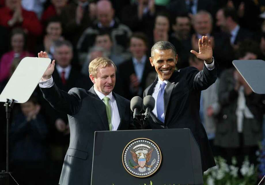 DUBLIN, IRELAND - MAY 23:  US President Barack Obama attends a rally at College Green with Taoiseach Enda Kenny, on May 23, 2011 in Dublin, Ireland. U.S. President Obama is visiting Ireland for one day. Earlier he met with Irish President Mary McAleese, Taoiseach (Prime Minister) of Ireland Enda Kenny and visited his ancestral home  in Moneygall, County Offaly.   (Photo by Irish Government - Pool/Getty Images) Photo: Pool, Getty Images / 2011 Getty Images