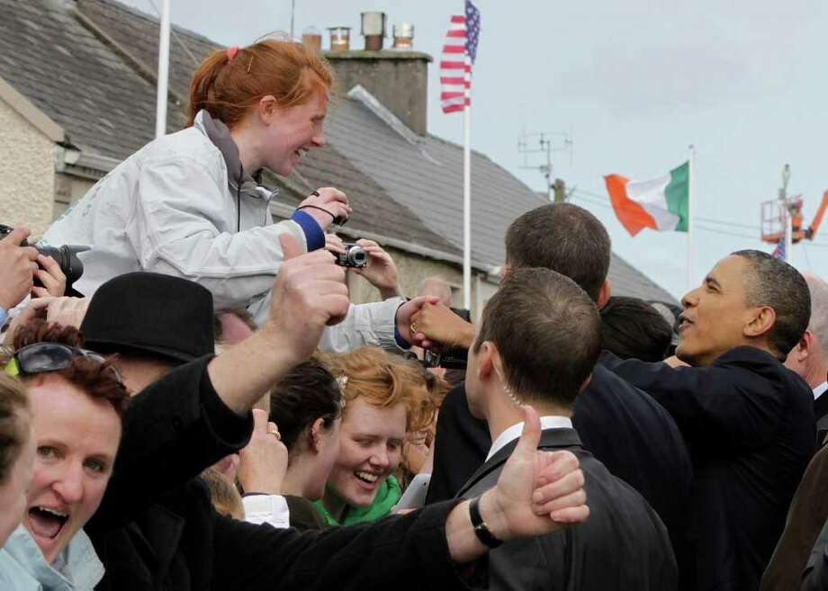 MONEYGALL, IRELAND - MAY 23:   U.S. President Barack Obama greets the locals in his ancestral home of Moneygall on May 23, 2011 in Moneygall, Ireland. U.S. President Obama is visiting Ireland for one day at the start of a week long tour of Europe. He will meet with distant relatives in Moneygall and speak at a rally in central Dublin after a concert.   (Photo by Irish Government - Pool/Getty Images) Photo: Pool, Getty Images / 2011 Getty Images