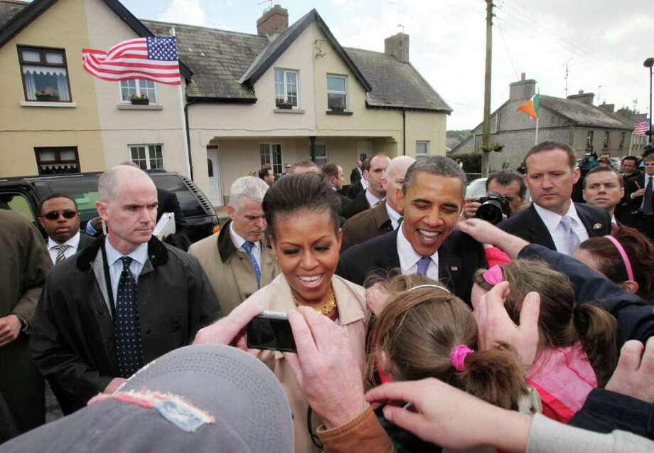 MONEYGALL, IRELAND - MAY 23:  U.S. President Barack Obama and First Lady Michelle Obama greet the locals in his ancestral home of Moneygall on May 23, 2011 in Moneygall, Ireland. U.S. President Obama is visiting Ireland for one day at the start of a week long tour of Europe. He will meet with distant relatives in Moneygall and speak at a rally in central Dublin after a concert.   (Photo by Irish Government - Pool/Getty Images) Photo: Getty Images