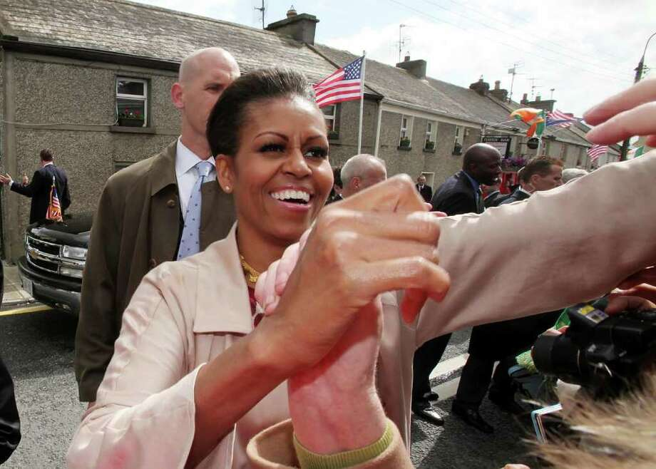MONEYGALL, IRELAND - MAY 23:  First Lady Michelle Obama greets the locals in her husbands ancestral home of Moneygall on May 23, 2011 in Moneygall, Ireland. U.S. President Obama is visiting Ireland for one day at the start of a week long tour of Europe. He will meet with distant relatives in Moneygall and speak at a rally in central Dublin after a concert.   (Photo by Irish Government - Pool/Getty Images) Photo: Getty Images