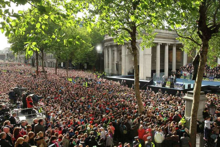 DUBLIN, IRELAND - MAY 23:  US President Barack Obama and First Lady Michelle Obama address the crowd  at College Green, on May 23, 2011 in Dublin, Ireland. U.S. President Obama is visiting Ireland for one day. Earlier he met with Irish President Mary McAleese, Taoiseach (Prime Minister) of Ireland Enda Kenny and visited his ancestral home  in Moneygall, County Offaly.   (Photo by Irish Government - Pool/Getty Images) Photo: Pool, Getty Images / 2011 Getty Images
