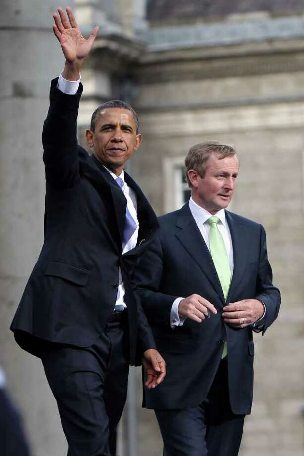 DUBLIN, IRELAND - MAY 23:  US President Barack Obama and Taoiseach Enda Kenny address the crowd  at College Green, on May 23, 2011 in Dublin, Ireland. U.S. President Obama is visiting Ireland for one day. Earlier he met with Irish President Mary McAleese, Taoiseach (Prime Minister) of Ireland Enda Kenny and visited his ancestral home  in Moneygall, County Offaly.   (Photo by Irish Government - Pool/Getty Images) Photo: Pool, Getty Images / 2011 Getty Images