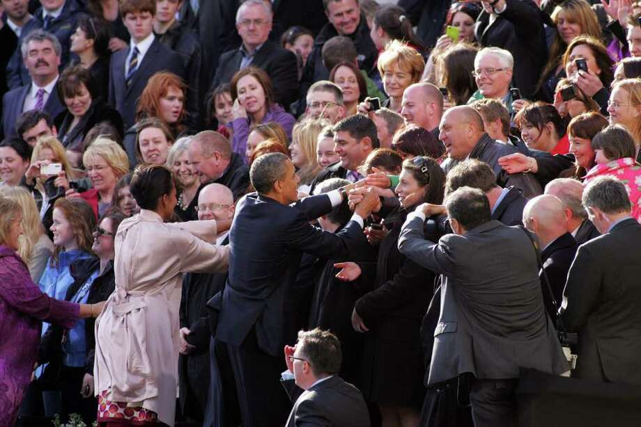 DUBLIN, IRELAND - MAY 23:  US President Barack Obama and First Lady Michelle Obama greet wellwishers at College Green, on May 23, 2011 in Dublin, Ireland. U.S. President Obama is visiting Ireland for one day. Earlier he met with Irish President Mary McAleese, Taoiseach (Prime Minister) of Ireland Enda Kenny and visited his ancestral home  in Moneygall, County Offaly.   (Photo by Irish Government - Pool/Getty Images) Photo: Pool, Getty Images / 2011 Getty Images
