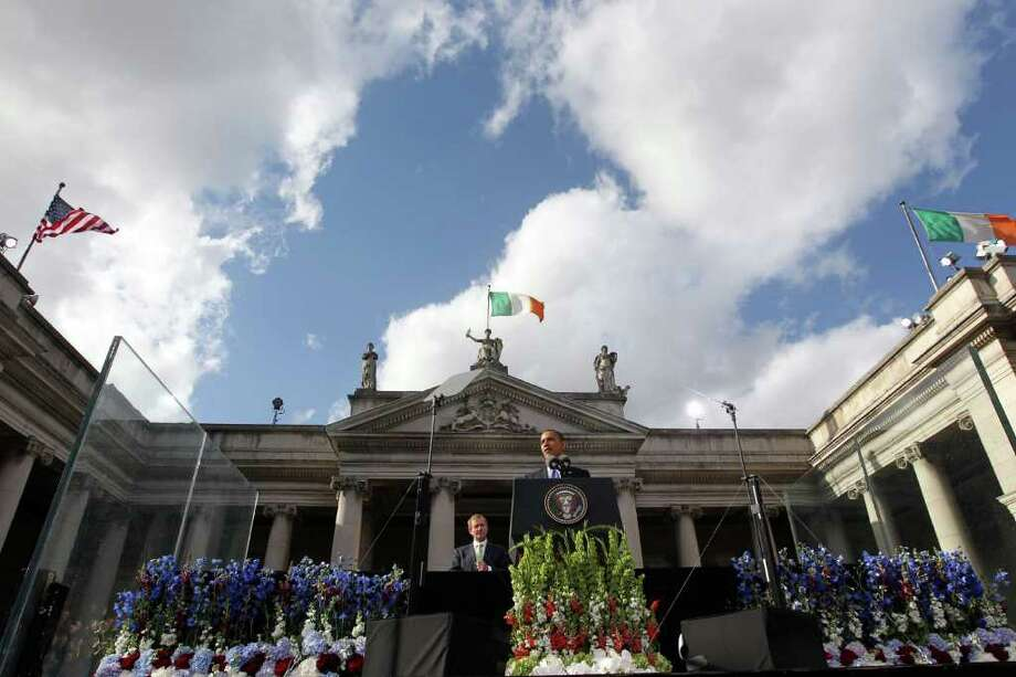 DUBLIN, IRELAND - MAY 23:  US President Barack Obama makes a speech as with An Taoiseach Enda Kenny (left) looks on at College Green, on May 23, 2011 in Dublin, Ireland. U.S. President Obama is visiting Ireland for one day. Earlier he met with Irish President Mary McAleese, Taoiseach (Prime Minister) of Ireland Enda Kenny and visited his ancestral home  in Moneygall, County Offaly.   (Photo by Irish Government - Pool/Getty Images) Photo: Pool, Getty Images / 2011 Getty Images