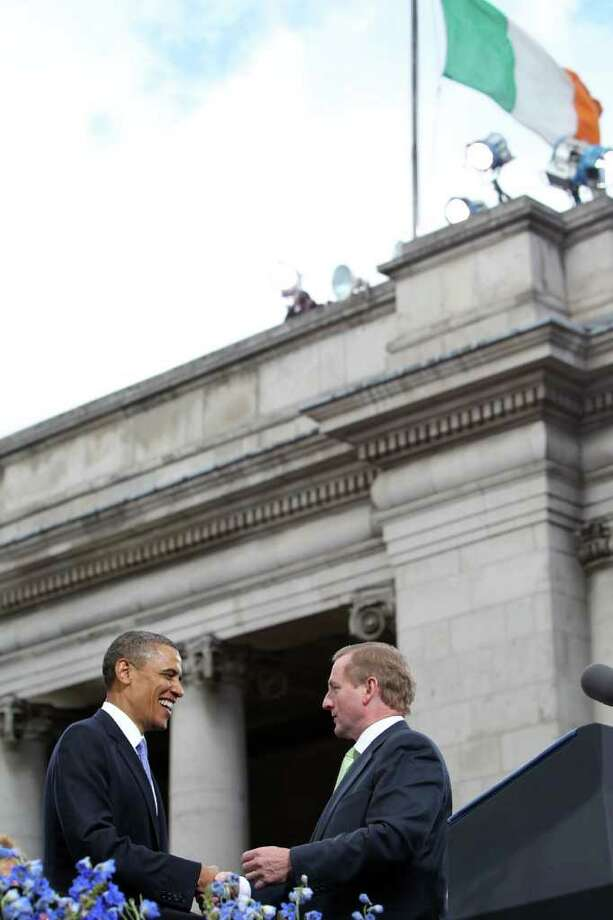 DUBLIN, IRELAND - MAY 23:  U.S. President Barack Obama shakes hands with Taoiseach Enda Kenny (R) as they address a crowd at College Green on May 23, 2011 in Dublin, Ireland. U.S. President Obama is visiting Ireland for one day at the start of a week long tour of Europe. Earlier he met with Irish President Mary McAleese, Taoiseach (Prime Minister) of Ireland Enda Kenny and visited his ancestral home  in Moneygall, County Offaly.   (Photo by Irish Government - Pool/Getty Images) Photo: Pool, Getty Images / 2011 Getty Images