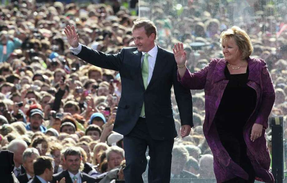 DUBLIN, IRELAND - MAY 23: Irish Prime Minister Enda Kenny waves as he arrives onstage with his wife Fionnuala Kenny before US President Barack Obama speaks in College Green on May 23, 2011 in Dublin, Ireland. U.S. President Obama is visiting Ireland for one day. Earlier he met with Irish President Mary McAleese, Taoiseach (Prime Minister) of Ireland Enda Kenny and visited his ancestral home  in Moneygall, County Offaly.   (Photo by Peter Macdiarmid/Getty Images) Photo: Peter Macdiarmid, Getty Images / 2011 Getty Images