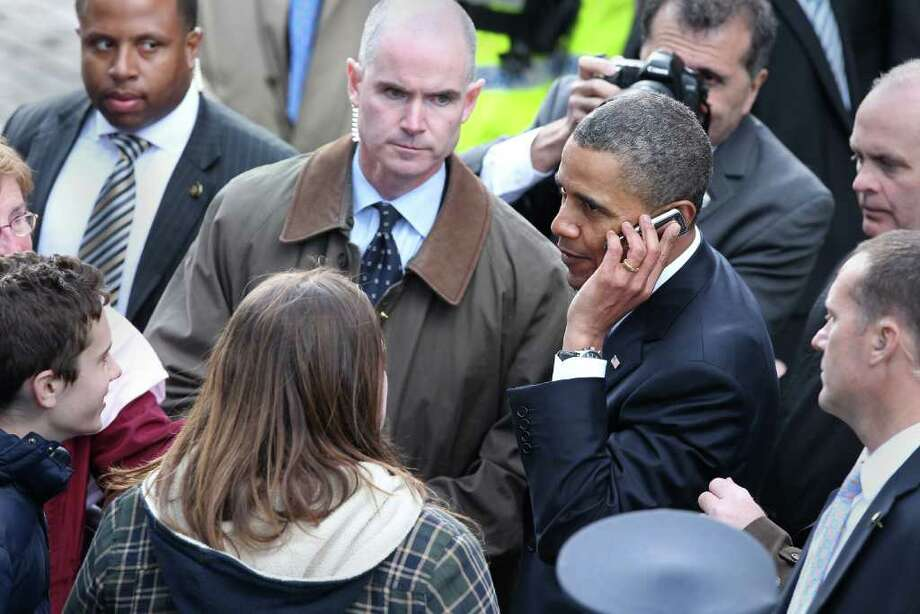 DUBLIN, IRELAND - MAY 23:  U.S. President Barack Obama speaks on a mobile telephone belonging to an audience member in College Green on May 23, 2011 in Dublin, Ireland. Obama is visiting Ireland for one day. Earlier he met with Irish President Mary McAleese and Taoiseach (Prime Minister) of Ireland Enda Kenny and visited his ancestral home  in Moneygall, County Offaly.   (Photo by Peter Macdiarmid/Getty Images) Photo: Peter Macdiarmid, Getty Images / 2011 Getty Images