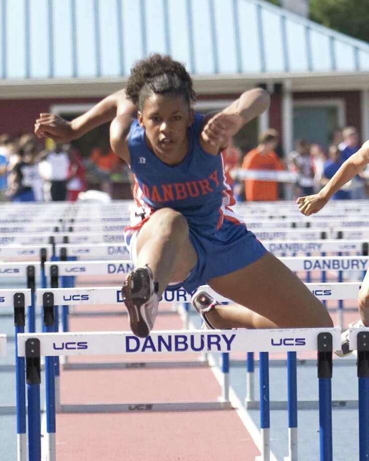 Danbury's Nyoshee Lowry wins the 100 high hurdles at the FCIAC Track and Field Championships Tuesday at Danbury High School. Photo: Barry Horn