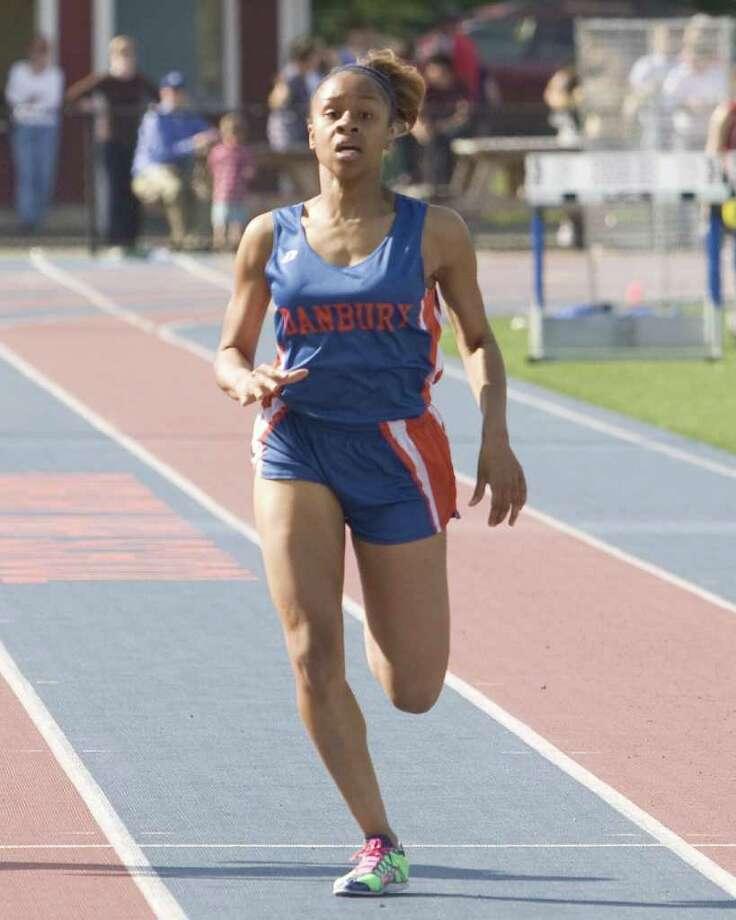 Danbury's Chelsea Wright wins the 400 meters at the FCIAC Track and Field Championships Tuesday at Danbury High School. Photo: Barry Horn