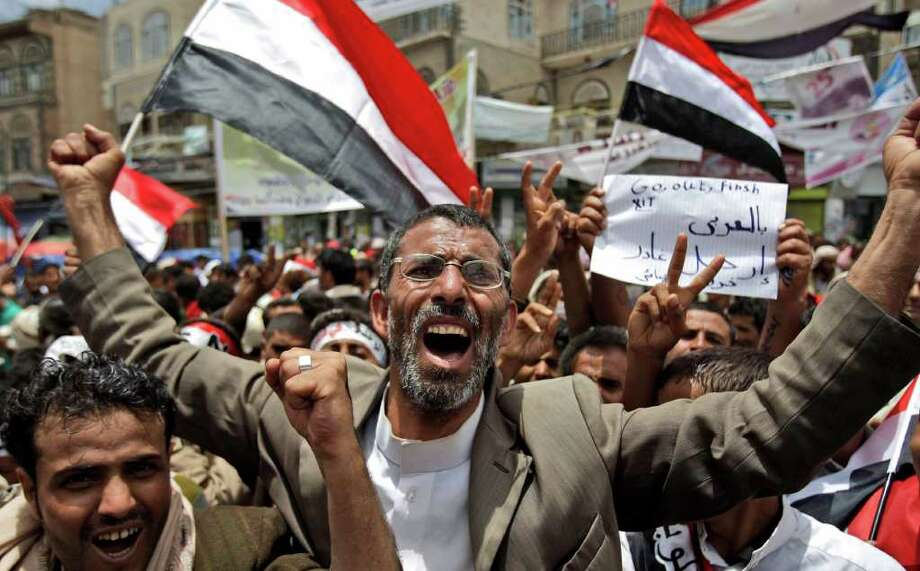 Anti-government protestors, react during a demonstration demanding the resignation of Yemeni President Ali Abdullah Saleh, in Sanaa, Yemen, Monday, May 23, 2011.  (AP Photo/Hani Mohammed) Photo: Hani Mohammed / AP