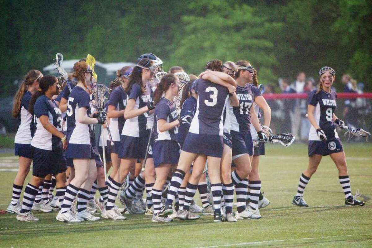 The Wilton Warriors celebrate their win over New Canaan High School in the girls lacrosse FCIAC semi-finals in New Canaan, Conn., May 23, 2011.