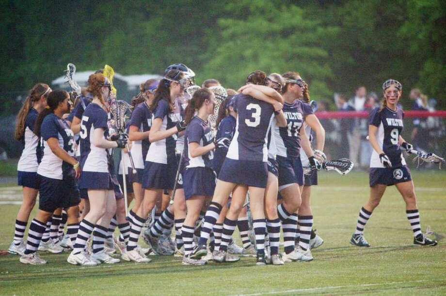 The Wilton Warriors celebrate their win over New Canaan High School in the girls lacrosse FCIAC semi-finals in New Canaan, Conn., May 23, 2011. Photo: Keelin Daly / Stamford Advocate