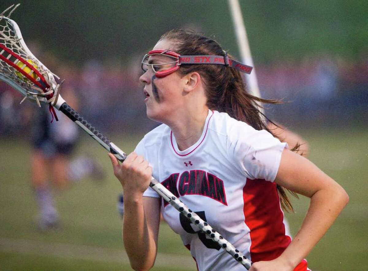 New Canaan's Brianna McEwan in action as New Canaan hosts Wilton High School in the girls lacrosse FCIAC semi-finals in New Canaan, Conn., May 23, 2011.