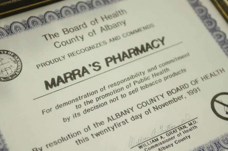 A certificate given to Marra's Pharmacy in 1991 from the Albany County Board of Health that recognized the pharmacy's decision to stop selling tobacco products.  This certificate hangs on the wall at Marra's Pharmacy seen here on Monday afternoon, May 23, 2011 in Cohoes.   Marra's Pharmacy stopped selling tobacco products in 1988.  (Paul Buckowski / Times Union) Photo: Paul Buckowski  / 00013251A