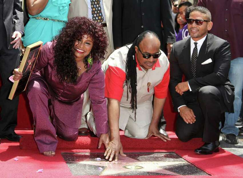 HOLLYWOOD, CA - MAY 19: Singers Chaka Khan (L), Stevie Wonder (C) and producer Benny Medina(R) attend the Chaka Khan Hollywood Walk Of Fame Induction Ceremony on May 19, 2011 in Hollywood, California. (Photo by Valerie Macon/Getty Images)