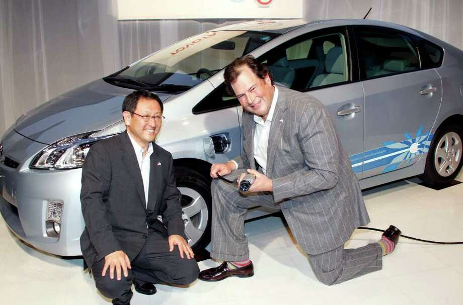 "Toyota Motor Corp. President Akio Toyoda, left, and Salesforce.Com chief executive Marc Benioff pose for photographers in front of a plug-in Prius hybrid during a joint press conference in Tokyo Monday, May 23, 2011. Japanese automaker Toyota and U.S. Internet company Salesforce.com, based in San Francisco, announced their alliance to launch ""Toyota Friend,"" a private social network for Toyota owners that works similar to tweets on Twitter. (AP Photo/Koji Sasahara) Photo: Koji Sasahara"