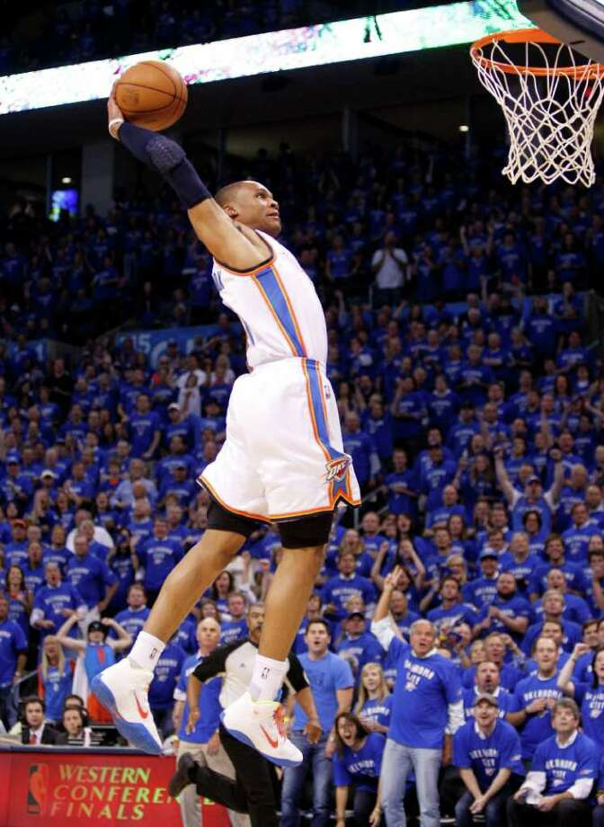 Oklahoma City Thunder's Russell Westbrook dunks against the Dallas Mavericks during first half of  Game 4 of the NBA Western Conference finals basketball series Monday, May 23, 2011, in Oklahoma City. (AP Photo/Eric Gay) Photo: Eric Gay