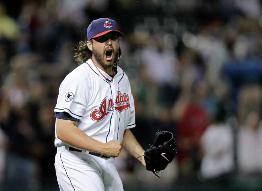 Cleveland Indians relief pitcher Chris Perez reacts to a game-ending double play and the Indians' 3-2 win over the Boston Red Sox in a baseball game Monday, May 23, 2011, in Cleveland. (AP Photo/Mark Duncan) Photo: Mark Duncan
