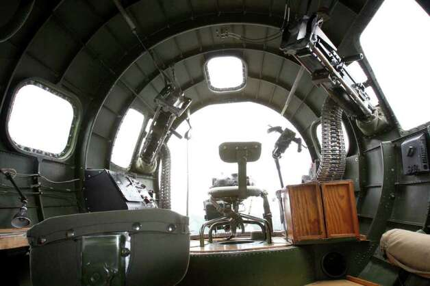"View from the inside of the bombadier's post of the WWII era B-17 aircraft named the ""Aluminum Overcast.""  On May 23, 2011 the Experimental Aircraft Association offered scenic flights to local journalists from the Museum of Flight at the Seattle Municipal Airport. Photo: Joe Dyer / SEATTLEPI.COM"