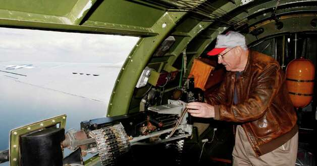 "WWII veteren Ted Gary re-enacts his war experiance aboard the B-17 aircraft named the ""Aluminum Overcast.""  On May 23, 2011 the Experimental Aircraft Association offered scenic flights to local journalists from the Museum of Flight at the Seattle Municipal Airport. Photo: Joe Dyer / SEATTLEPI.COM"