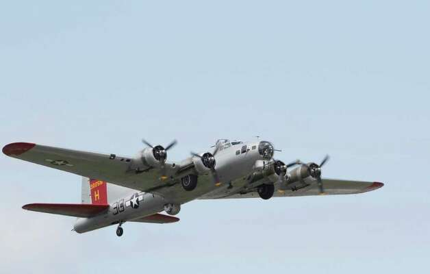 "WWII era B-17 aircraft named the ""Aluminum Overcast,"" takes off from Boieng Field on May 23, 2011 the Experimental Aircraft Association offered scenic flights to local journalists from the Museum of Flight at the Seattle Municipal Airport. Photo: Joe Dyer / SEATTLEPI.COM"