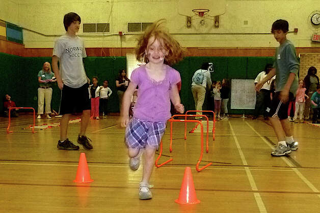 At Fox Run Elementary School in Norwalk, students enjoyed an obstacle course activity as part of Fit Kids Field Day on Wednesday, May 18. Photo: Contributed Photo / Mike Lauterborn, Contributed Photo / Norwalk Citizen