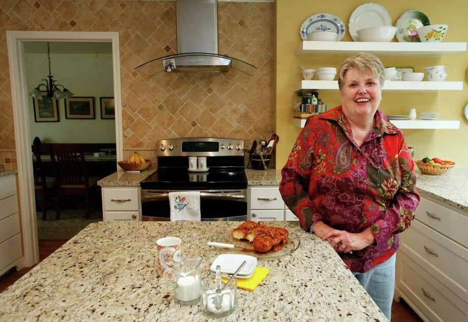 Liz Malloy added an island to her kitchen in the makeover. Granite counters work well for kneading bread. Photo: J. Michael Short, SPECIAL TO THE EXPRESS-NEWS / THE SAN ANTONIO EXPRESS-NEWS