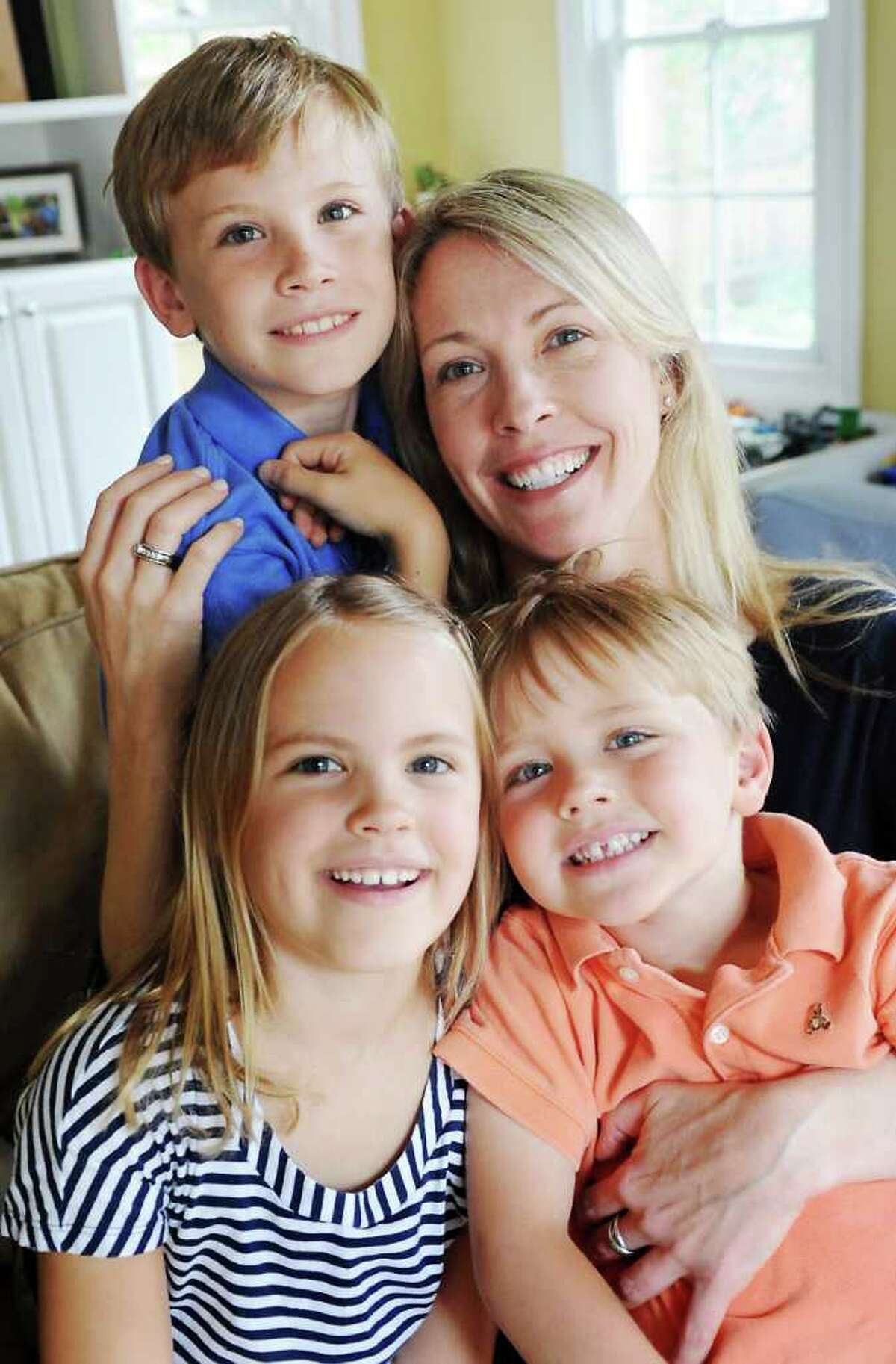 Erin O'Toole is the new program manager for Hope in Motion, where 100% of the donations raised support services at the Bennett Cancer Center: . She sits with her children Sean O'Toole, 9, Bridget O'Toole, 7, and Ryan O'Toole, 4, in their family room in Darien, Conn. on Tuesday May 24, 2011. Four and a half years ago, O'Toole lost her husband John O'Toole to brain cancer, and as a teenager growing up in Hunter Mountain,N.Y. she lost her mother Maureen Gallagher to breast cancer.